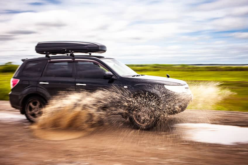 Subaru Forester driving in the mud road